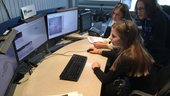 High school students take part in a live simulation at ESOC, commanding a virtual rover across a lunar landscape