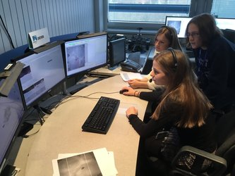 Students drive a virtual rover over a lunar landscape
