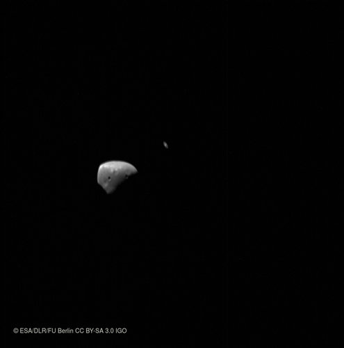 Deimos and Saturn