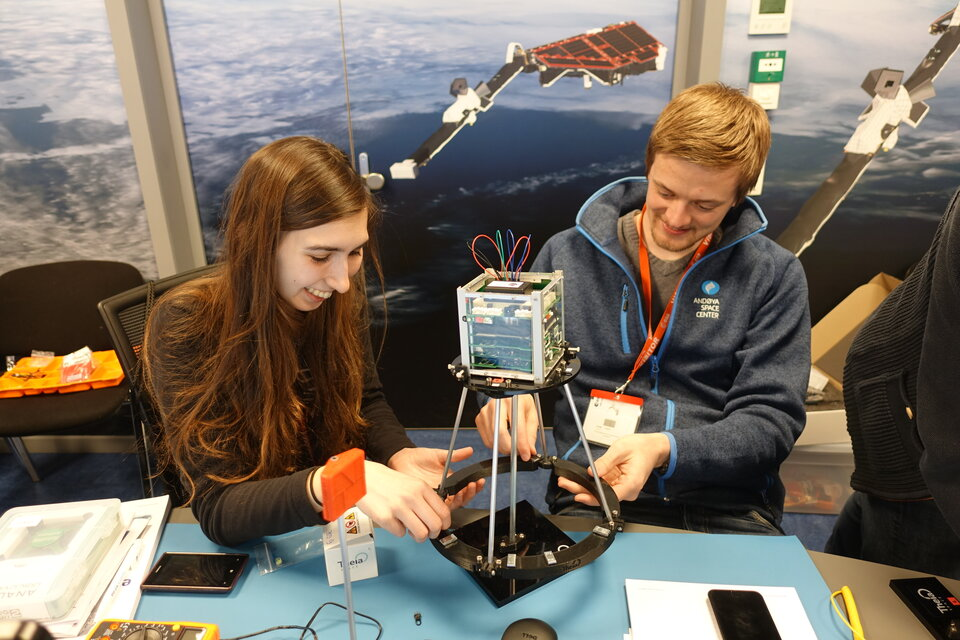Students performing experiments on their ESAT model during the pilot edition of the ESA Academy's CubeSat Hands-On Training Week.