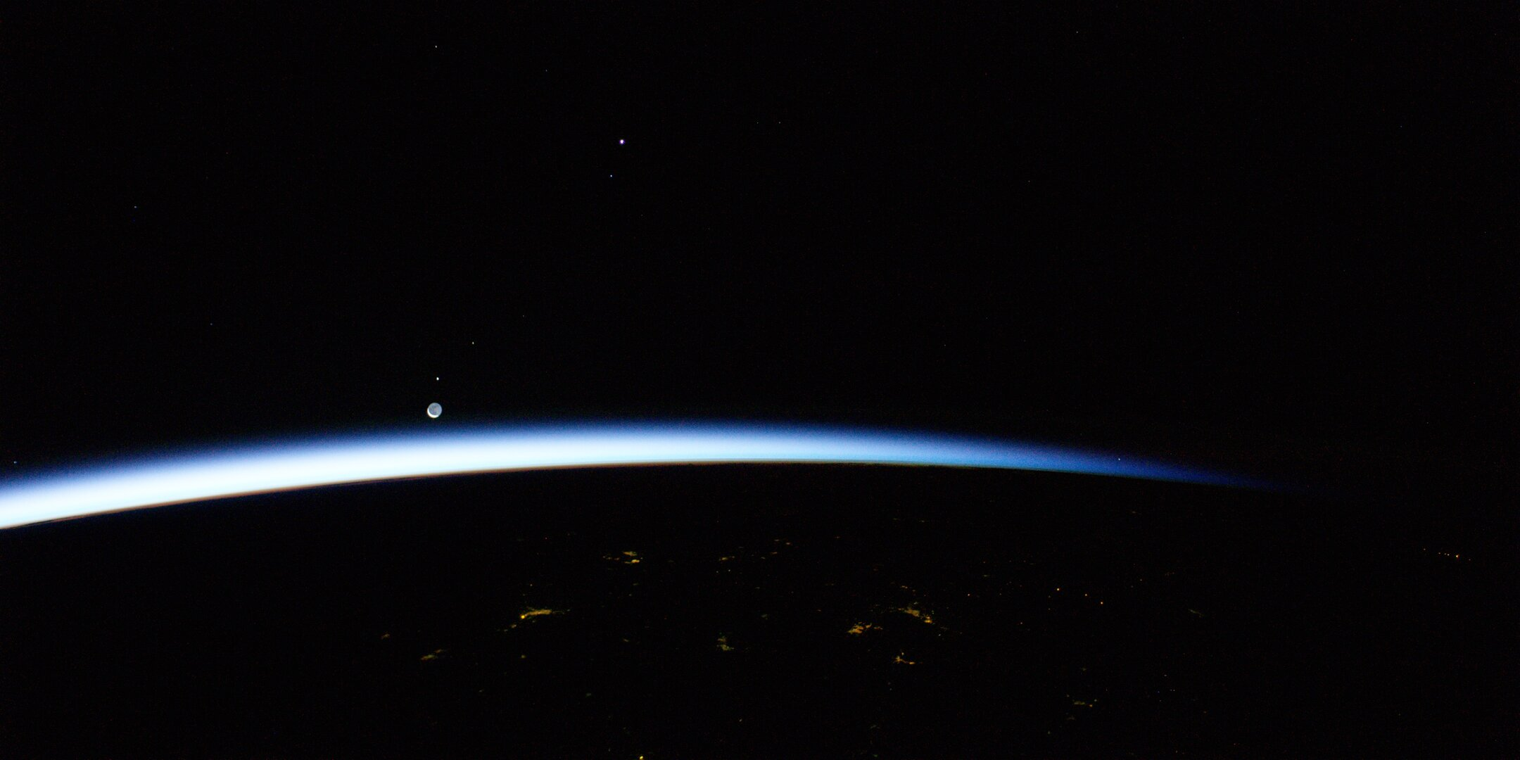 The Moon and Mars rising above Earth seen from the Space Station