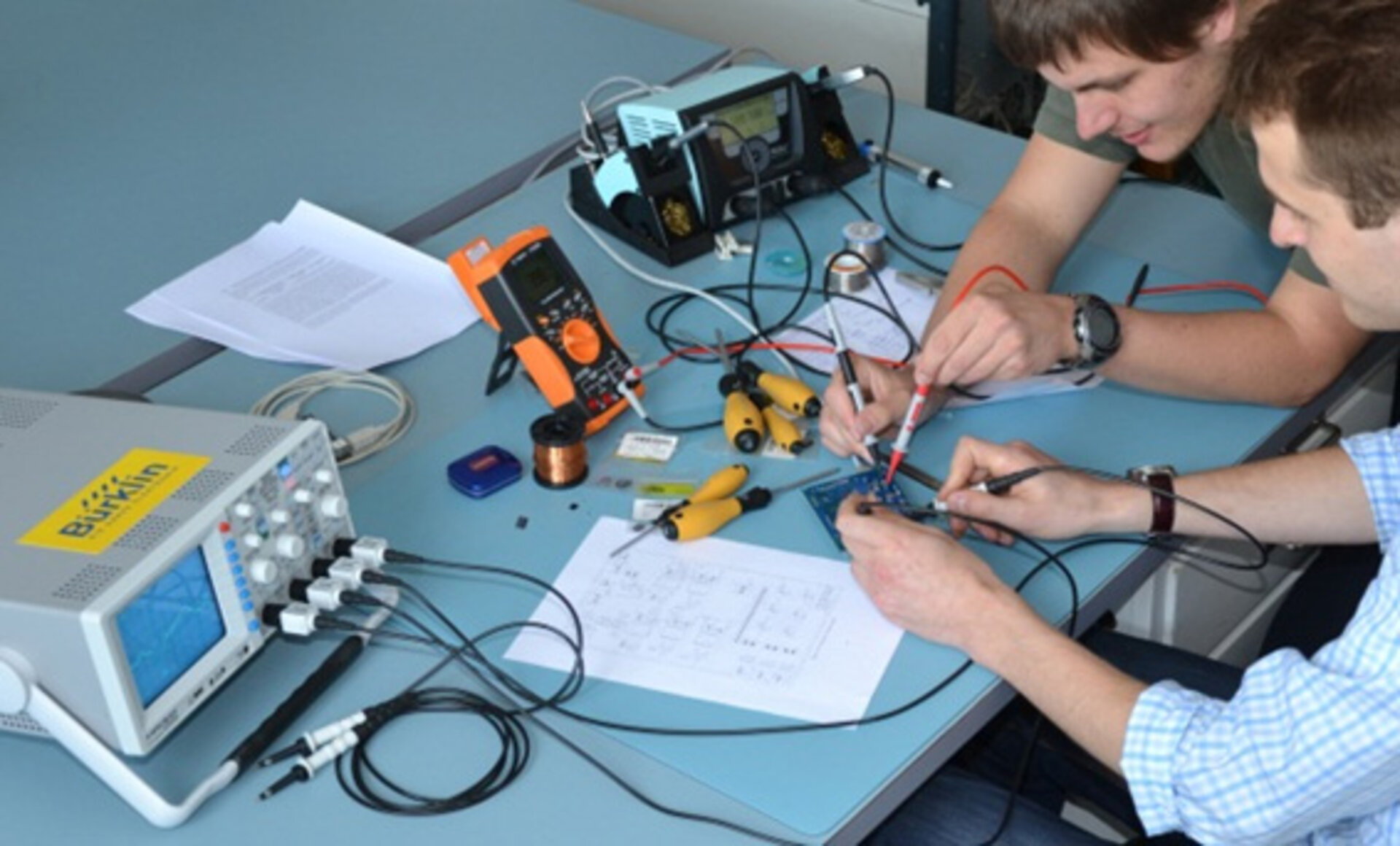 Students perform measurements on electronics hardware