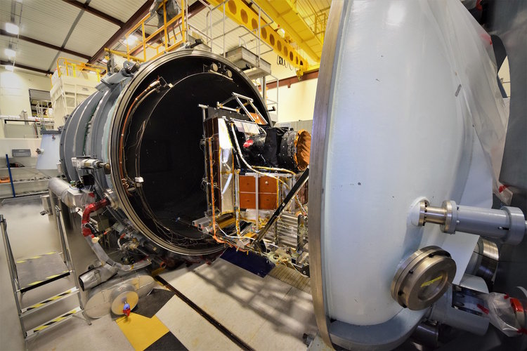Loading Cheops into a thermal-vacuum chamber