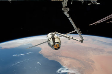 Dragon spacecraft leaving Space Station