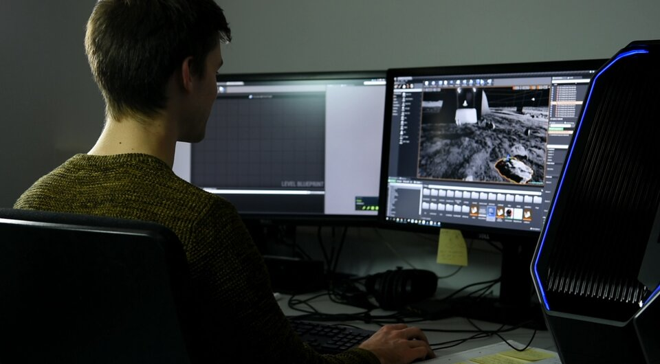 ESA trainee Sander Coene works on a virtual reality platform for robotics