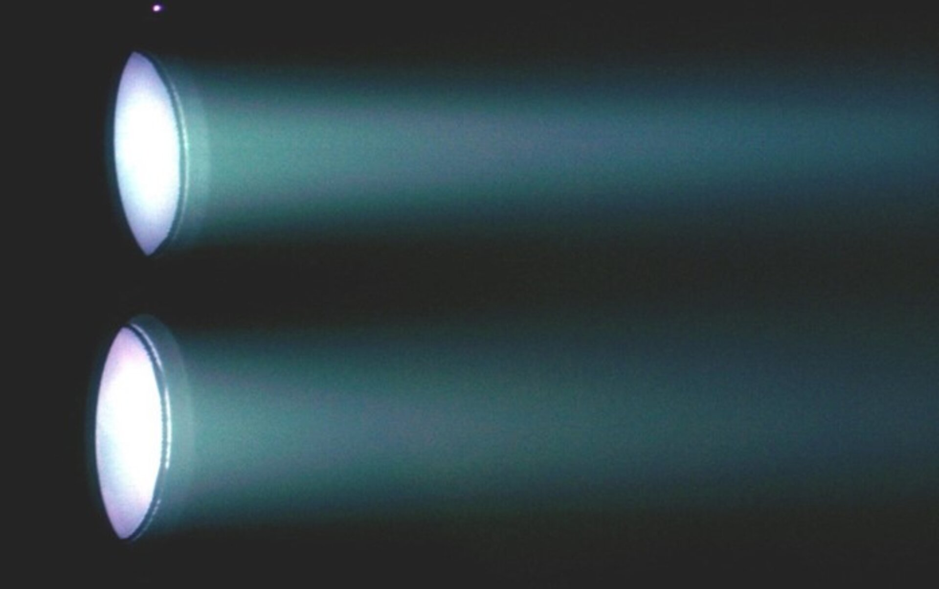 Twin ion thrusters firing