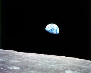 Iconic image of Earth rising above lunar surface