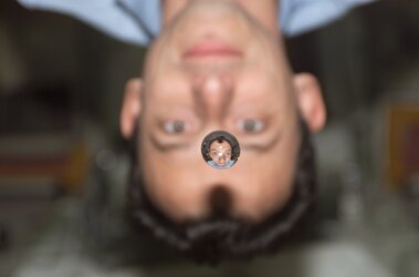 Astronaut Pedro Duque through a water drop