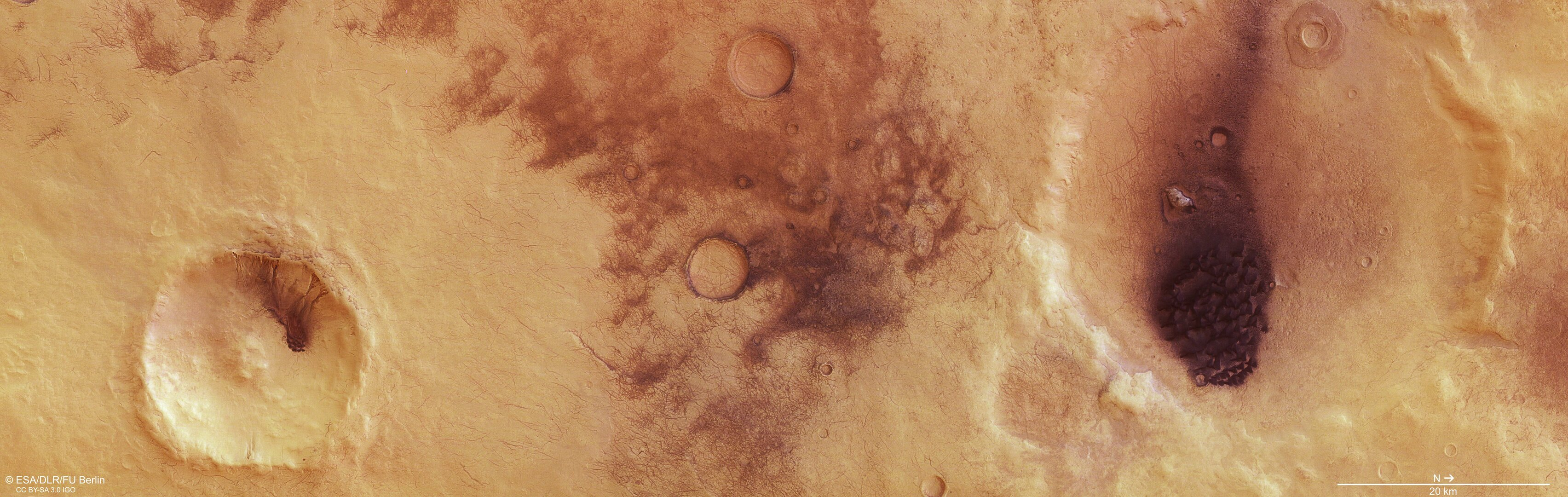 Dust devils in Chalcoporos Rupes