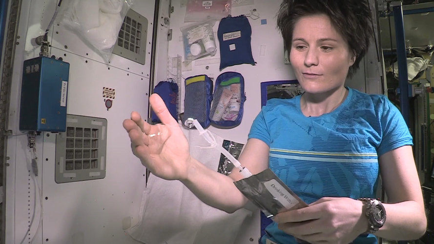 Samantha Cristoforetti with water on Space Station