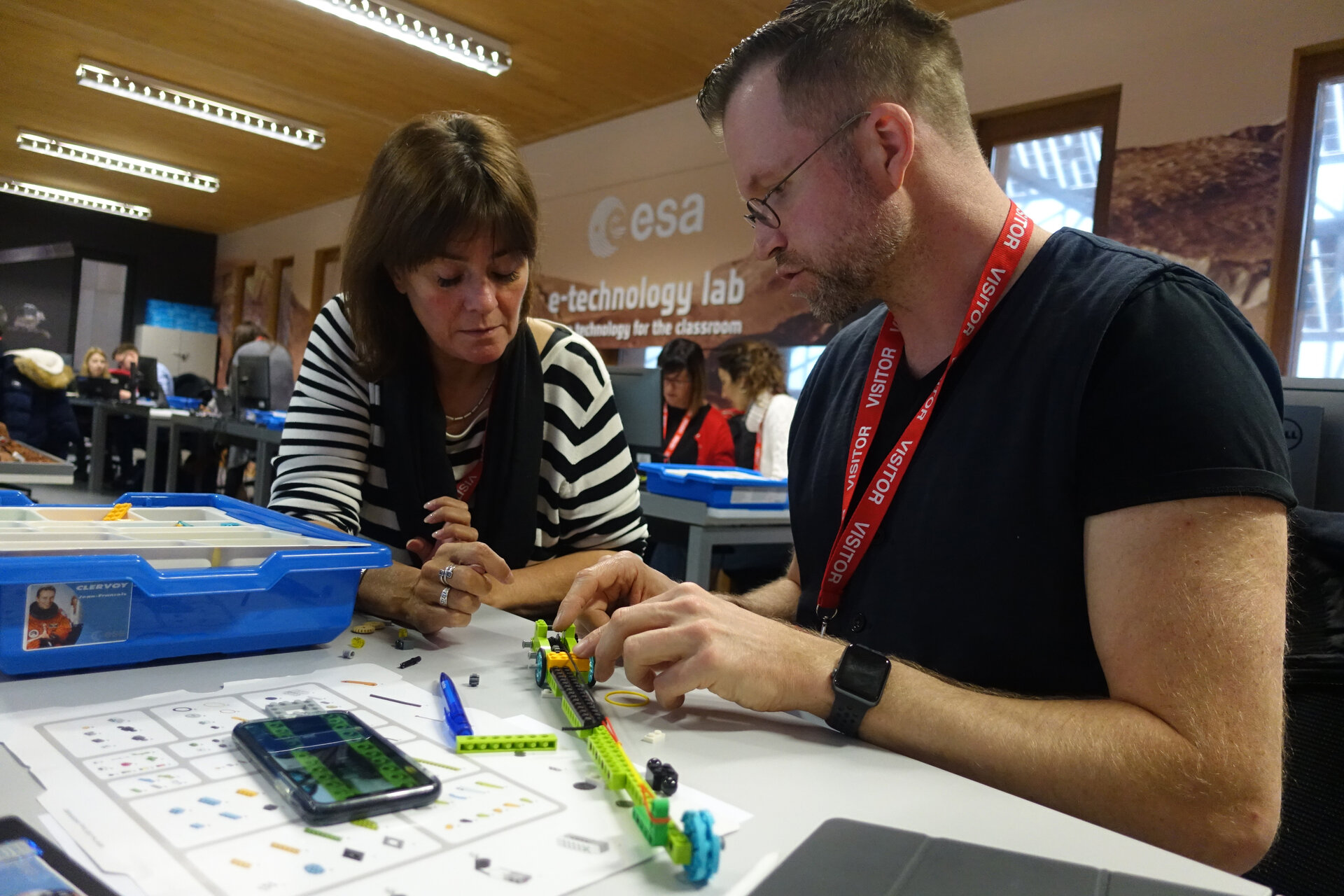 Teachers building a rover together