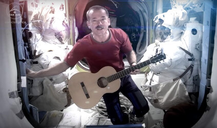 Astronaut plays guitar in space