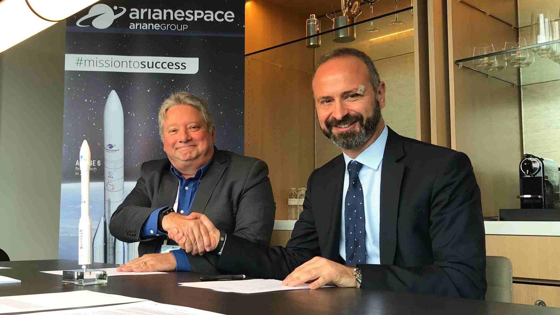 Peter Mabson of exactEarth (left) and Geoffroy Legros of Arianespace sign the launch contract for ESAIL