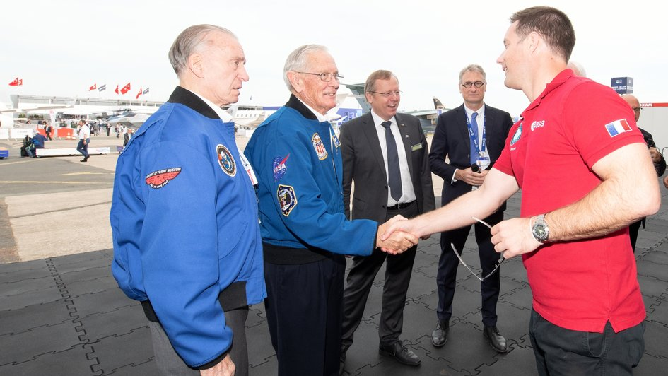 ESA astronaut Thomas Pesquet welcomes three Apollo astronauts to the ESA stand at Le Bourget