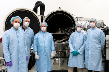 LaRa team beside thermal vacuum chamber