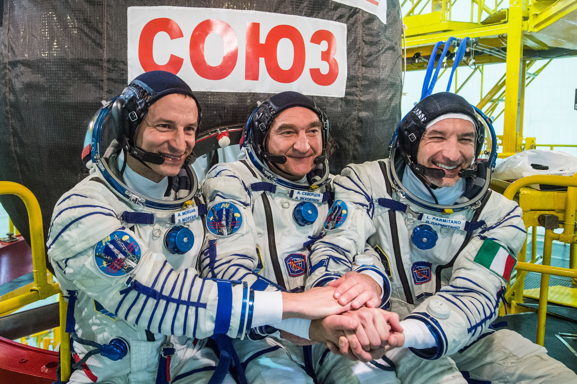 Luca Parmitano with his crew in front of their Soyuz spacecraft