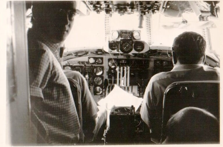 Valeriano Claros Guerra in cockpit of NASA test aircraft overflying Canary Island station during Apollo flights simulations.