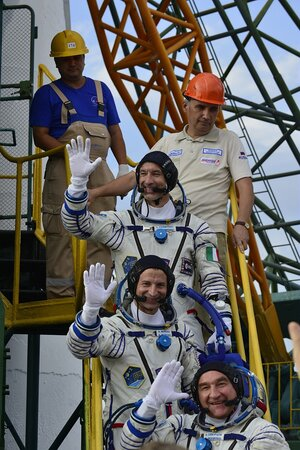 Soyuz MS-13 crew wave from the steps to their Soyuz MS-13 spacecraft