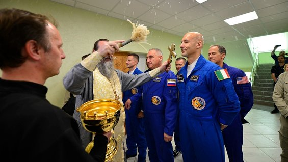 Soyuz MS-13 crew receive the traditional blessing from a Russian Orthodox priest