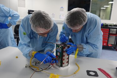 Students performing checks on their CubeSat