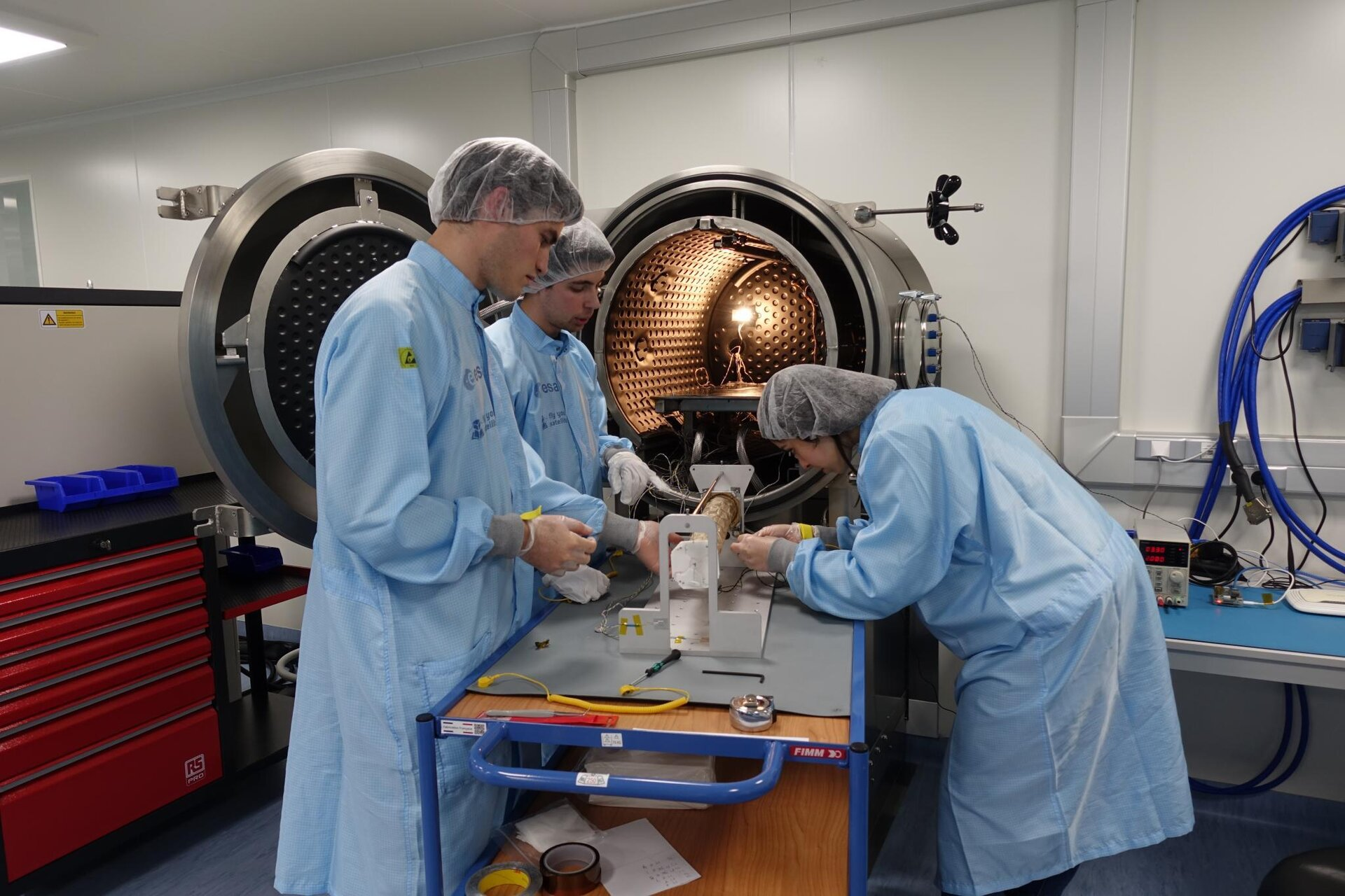 University students testing at the CubeSat Support Facility