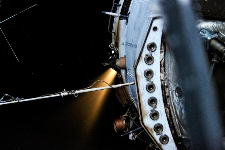 Zvezda burning its engines to adjust the Space Station's orbit