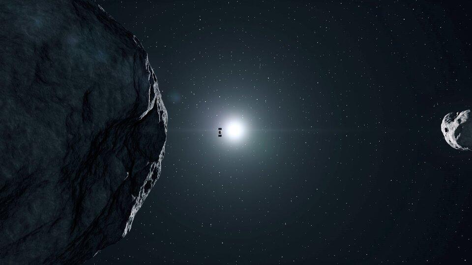 Hera aux environs de Didymos, un système de deux astéroïdes géocroiseurs (vue d'artiste). La collision d'un astéroïde avec la Terre est aujourd'hui la seule catastrophe naturelle que l'on pourrait à la fois prévoir et éviter.