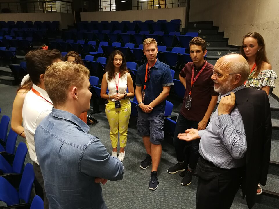 Prof. Armel Kerrest, ECSL Vice-Chairman, discussing with students after his lecture at the 2019 Summer Course