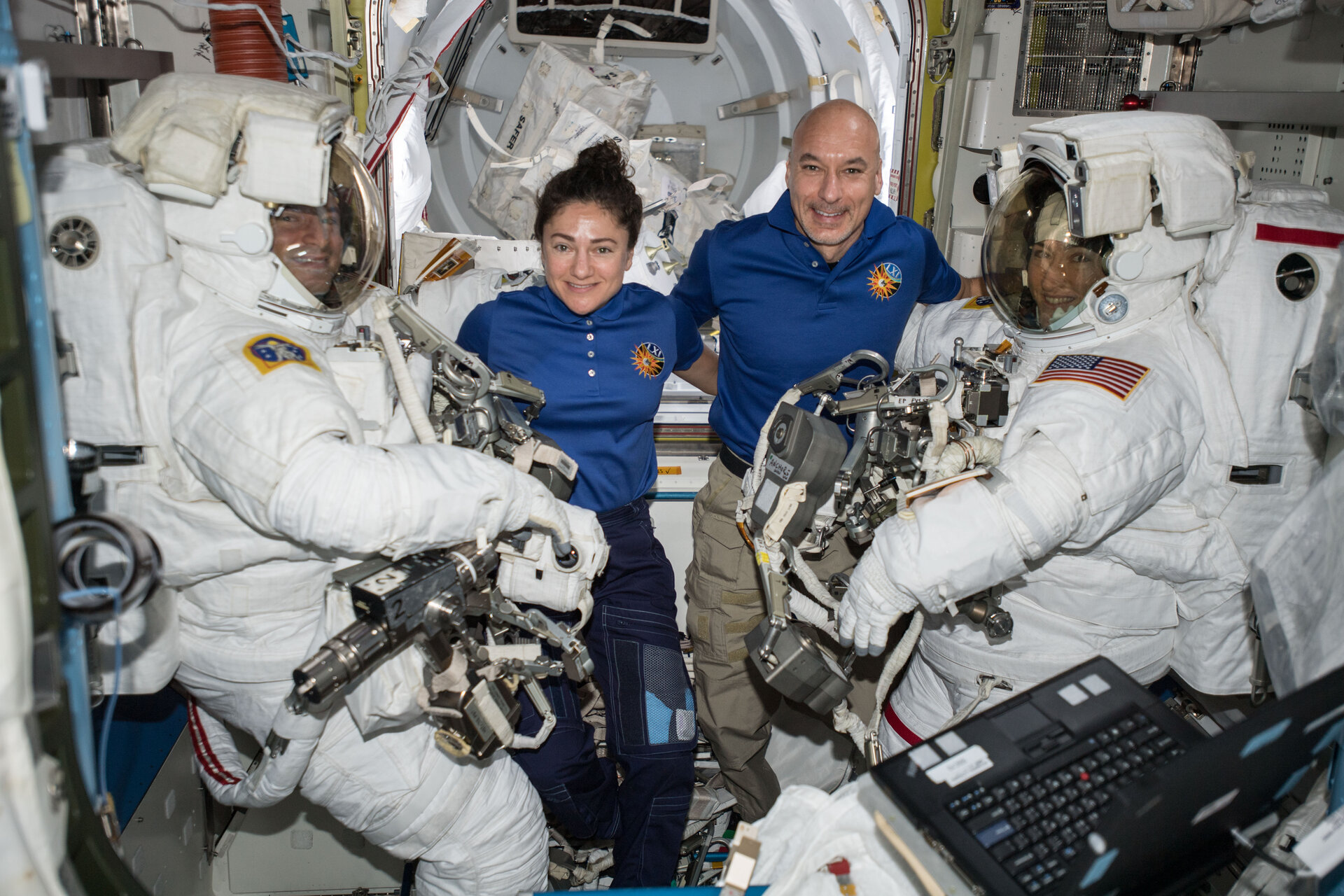 ESA astronaut Luca Parmitano assists spacewalkers in the Quest airlock