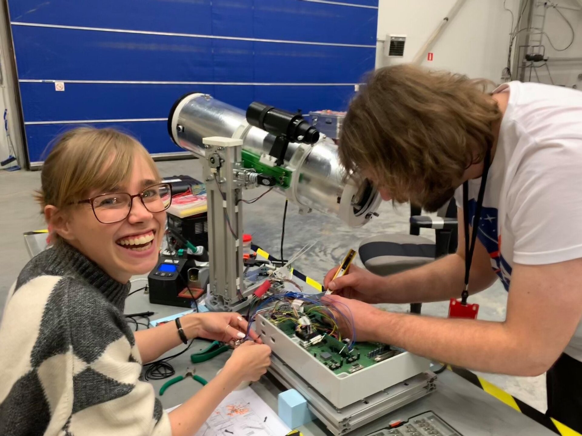 IRISC Team working on their experiment before flight