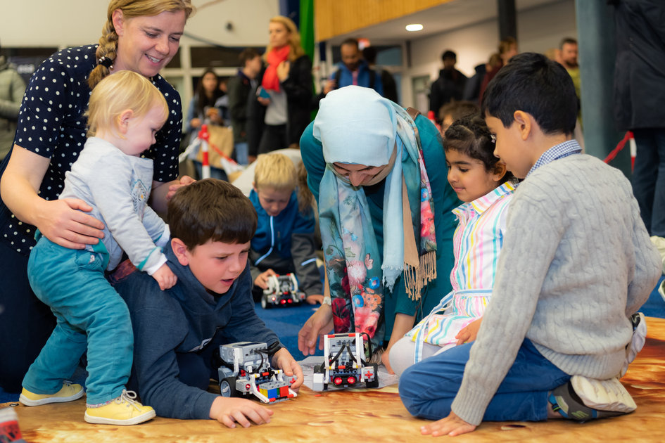 Parents and kids play and learn with robotic rovers