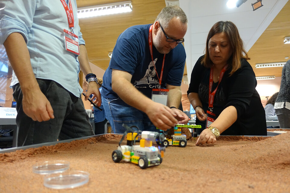 Primary school teachers exploring the surface of planet Mars.