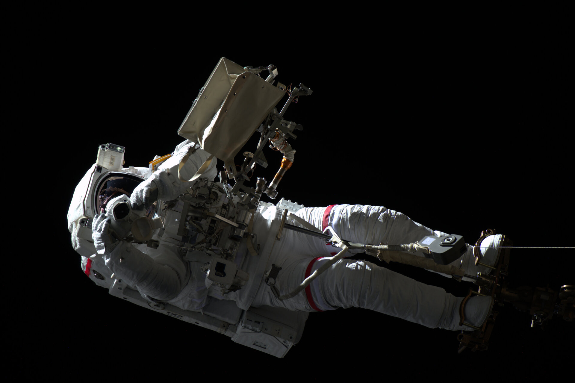 Luca photographed by Oleg Skripochka from inside the International Space Station