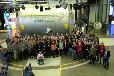 Teams and the panel with the Columbus mock-up during the Selection Workshop