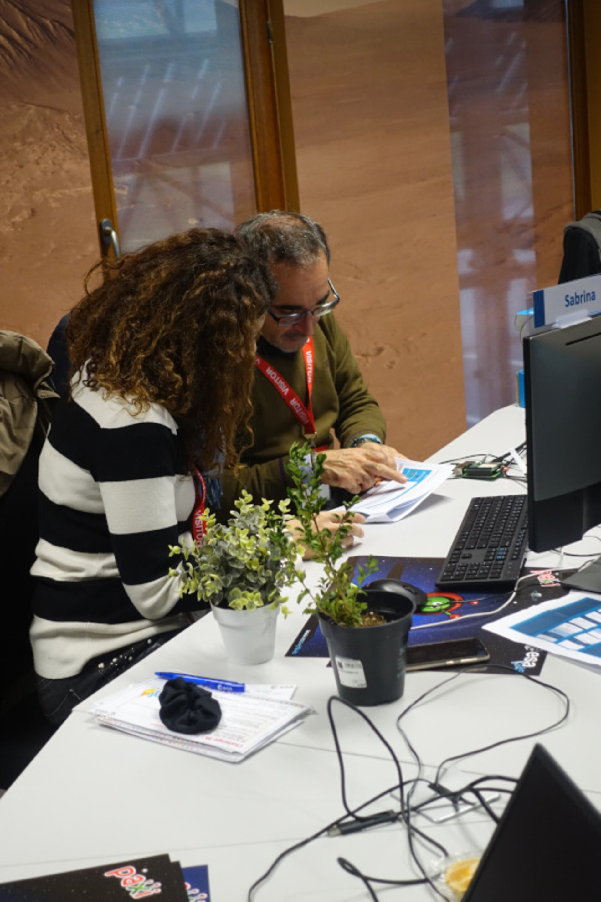 Teachers using the Astro Pi to distinguish a fake plant from a real one