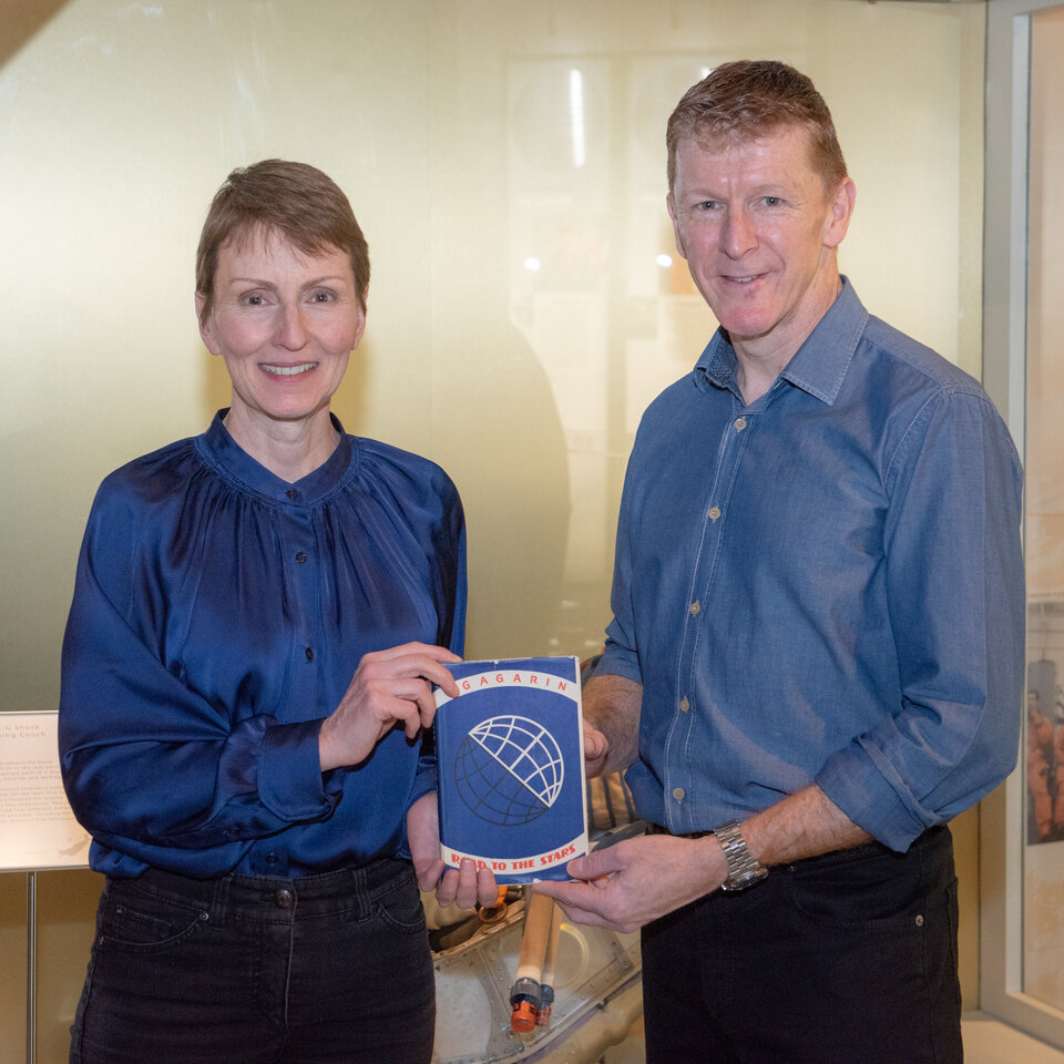 British astronauts Helen Sharman and Tim Peake with the book that has twice flown into space
