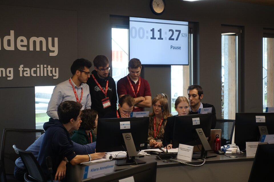Time is ticking away while team Sagittarius discusses possible causes and solutions for their spacecraft's communication problems