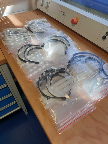 One stack of EAC 3D printed parts for face shields in bags ready for delivery