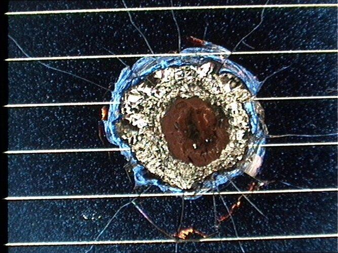 Hubble solar cell impact damage