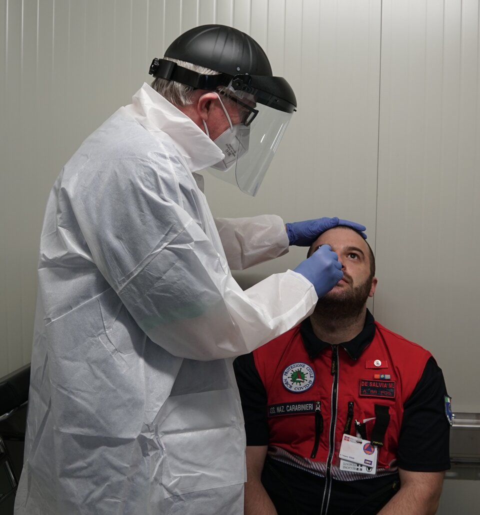 A nasal swab is taken from a key worker in Piedmont