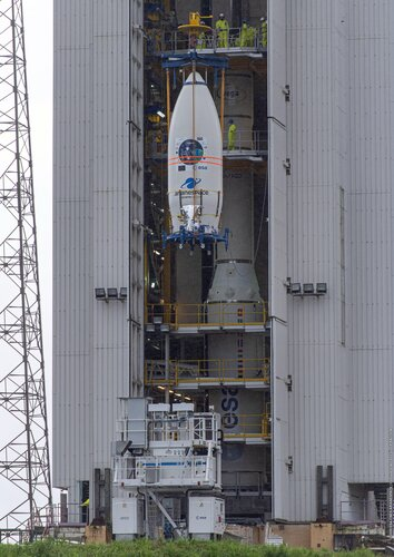 Vega's ridesharing satellites secured on the SSMS dispenser inside the fairing are hoisted to the top of the mobile gantry at Europe's Spaceport.