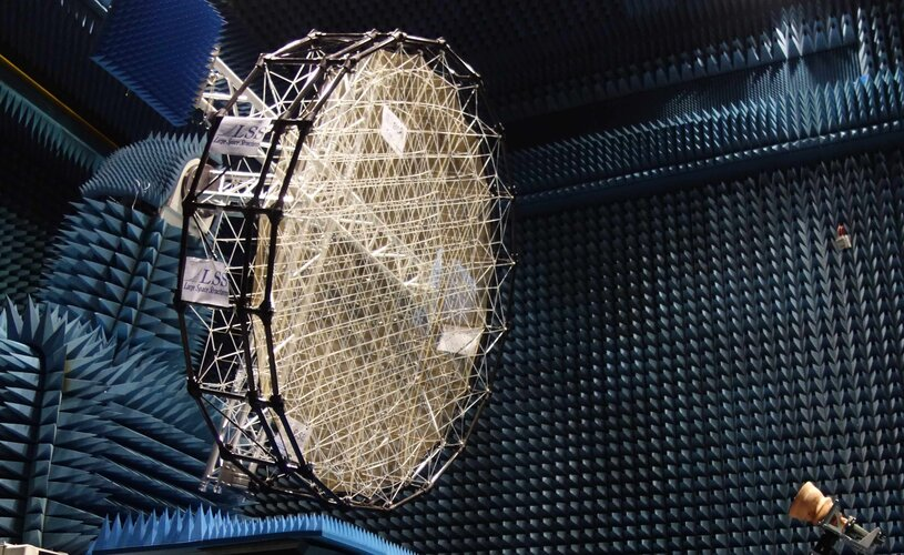Mesh reflector for shaped radio beams