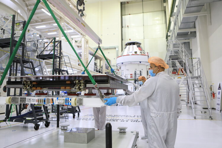 Installing solar wings on Orion