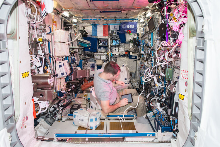 Thomas Pesquet works in the European Columbus laboratory in space