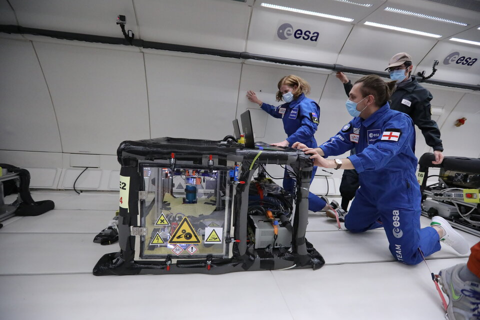 RELOX team in weightlessness being overlooked by a Novespace engineer