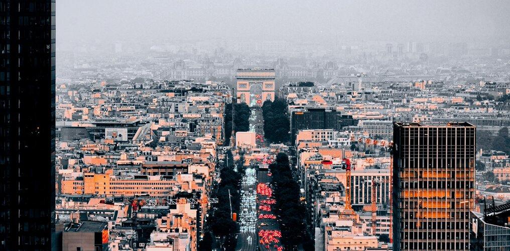 Urban traffic around the Arc de Triomphe in Paris