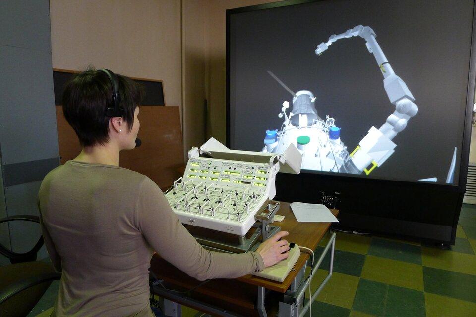 Samantha Cristoforetti trains with the European Robotic Arm