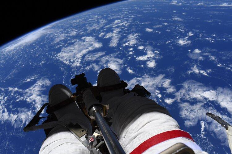 ESA astronaut Thomas Pesquet overlooking Earth during a spacewalk
