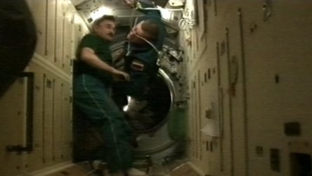 Astronauts entering the ISS